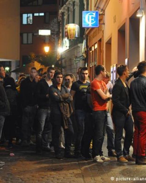 Men wait to get into a nightclub in Germany