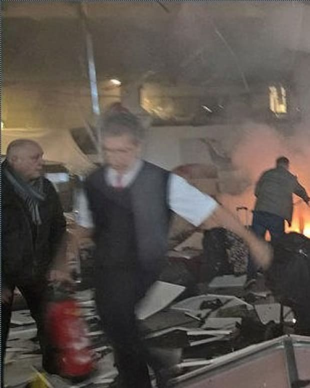 Brussels Attacks Kill 31, Police Raid Buildings Promo Image