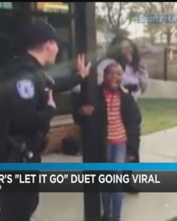 a virginia police officer singing with a local child