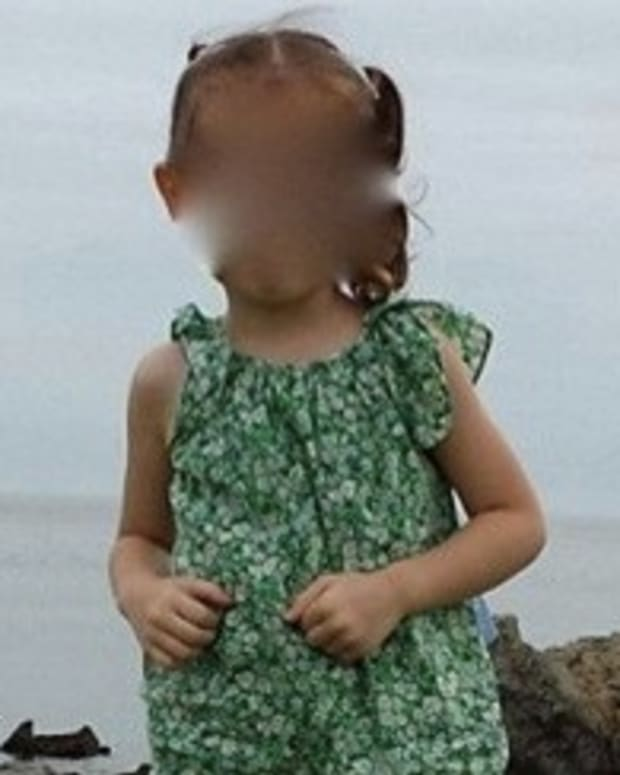 Parents Notice Something Frightening In Background Of Little Girl's Pic (Photo) Promo Image