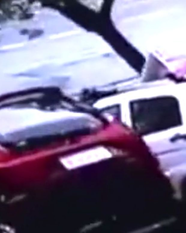 Giant Sinkhole In China Swallows Four Cars (Video) Promo Image