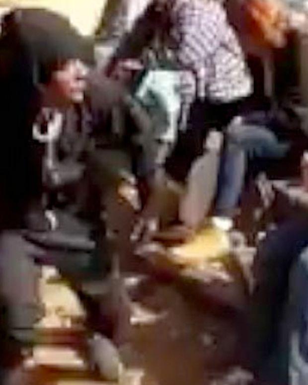 screenshot, man beating homeless woman