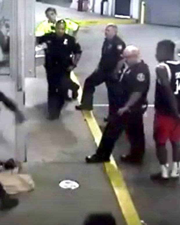 Cop Punches Handcuffed Woman As Others Watch (Video) Promo Image