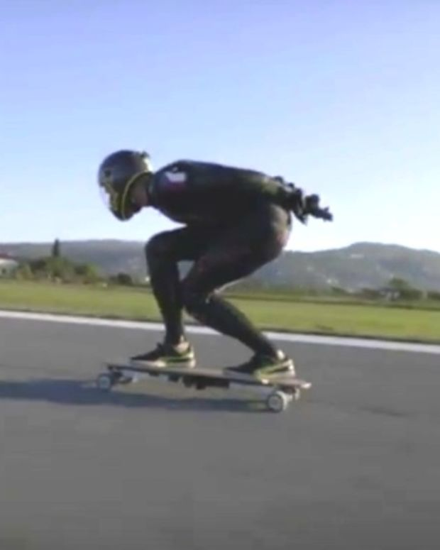 Man Sets World Record On Electric Skateboard (Video) Promo Image