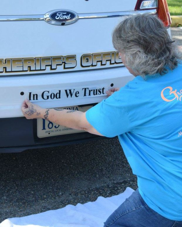 'In God We Trust' Added To V.A. County Police Cars Promo Image