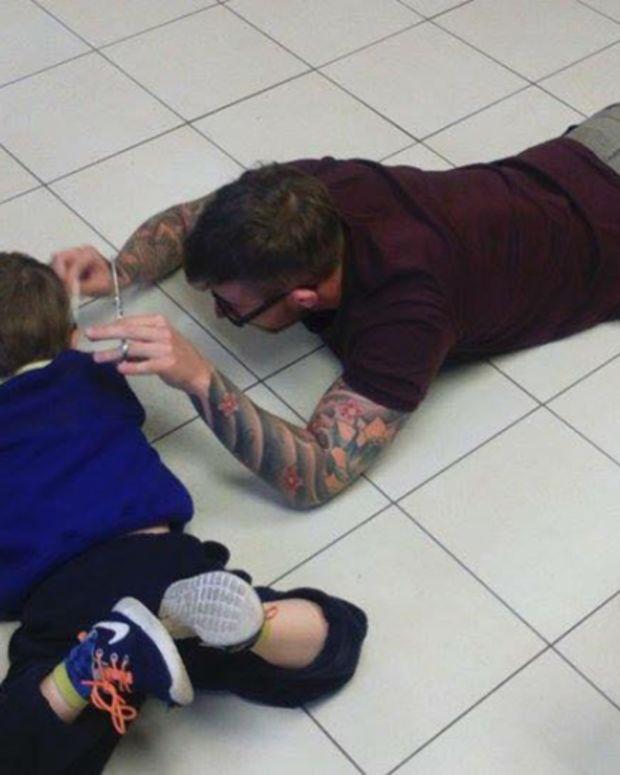 James Williams cutting Mason's hair on the floor