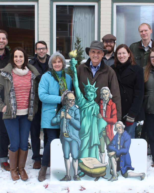 people gathered around Freedom From Religion Foundation's Nativity display