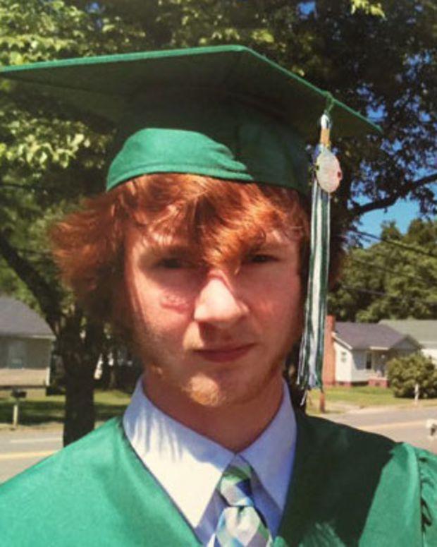 Mason Cox With Graduation Balloons.