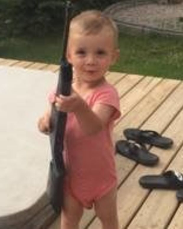 Photo Of 2-Year-Old With BB Gun Goes Viral (Photos) Promo Image