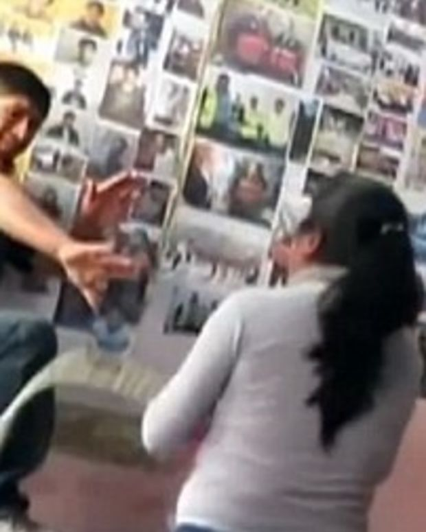 Suzana Vasquez whipping her husband