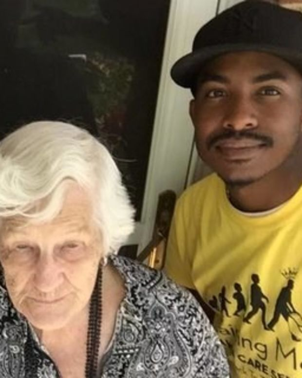 Photo Of Men Helping Elderly Woman Mow Lawn Goes Viral Promo Image