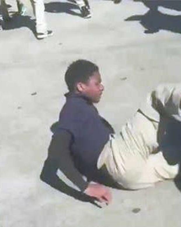 Cop Body Slams Seventh-Grader At Bus Stop (Video) Promo Image