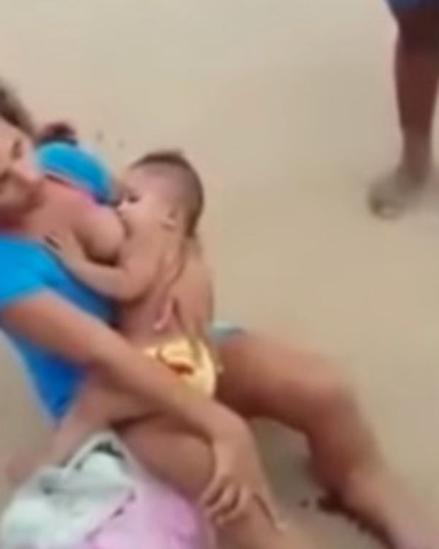 People See Woman Breastfeeding On The Ground, Then Notice The Blood (Photos) Promo Image
