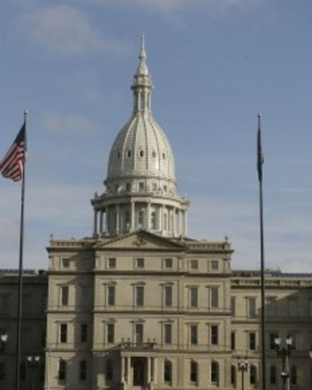 Michigan House Approves Strict Voter ID Bill  Promo Image