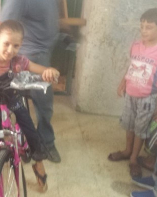 Israeli Buys Palestinian Girl A Replacement Bicycle Promo Image