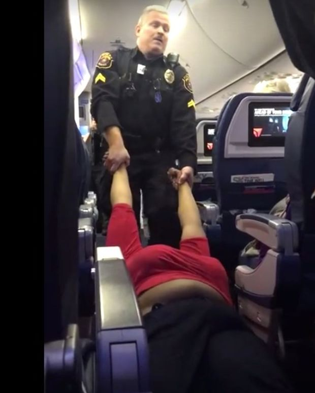 Police Drag Woman Off Delta Flight In Detroit (Video) Promo Image