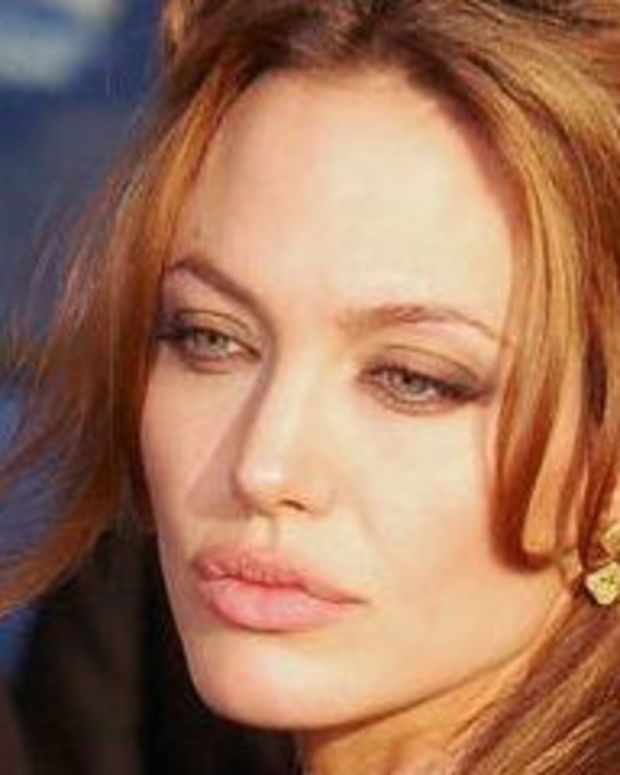 Angelina Jolie Buys Teddy Bear From Young Twins (Video) Promo Image