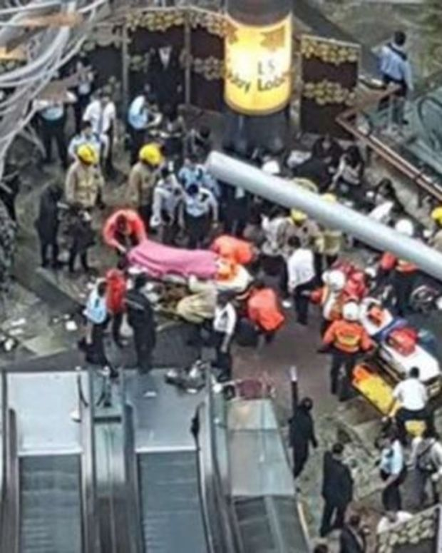18 Injured When Escalator Speeds Up, Reverses Direction (Video) Promo Image