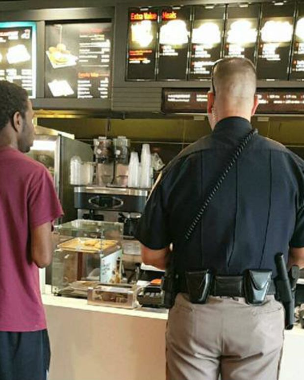 Cop Pays For Black Teen's Food (Photo) Promo Image