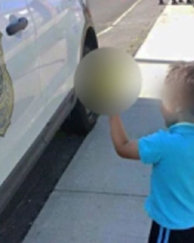 Photo Of Boy Flipping Off Police Goes Viral (Video) Promo Image