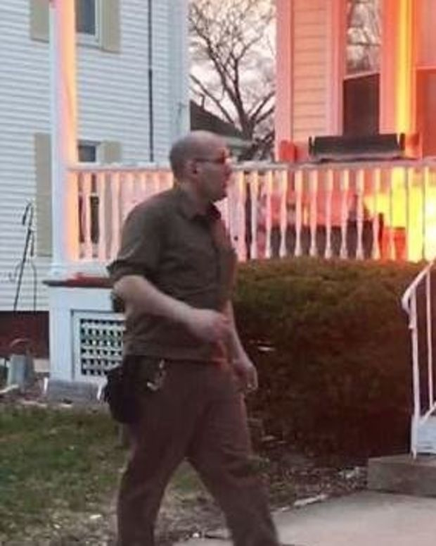 UPS Driver Saves Family From House Fire (Video) Promo Image