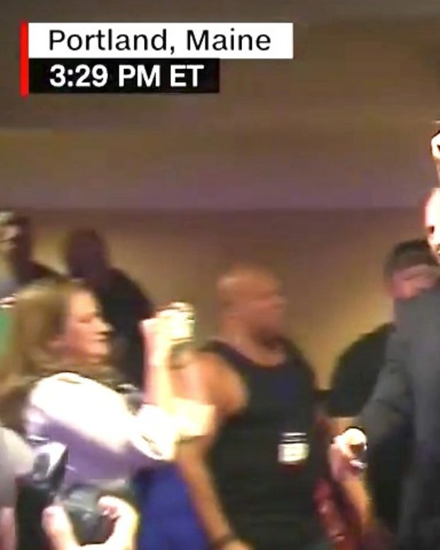Trump Fans Boo Protesters Holding Constitution (Video) Promo Image