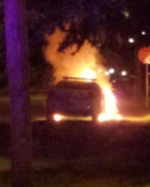Police Car Firebombed Outside Florida Mosque  Promo Image