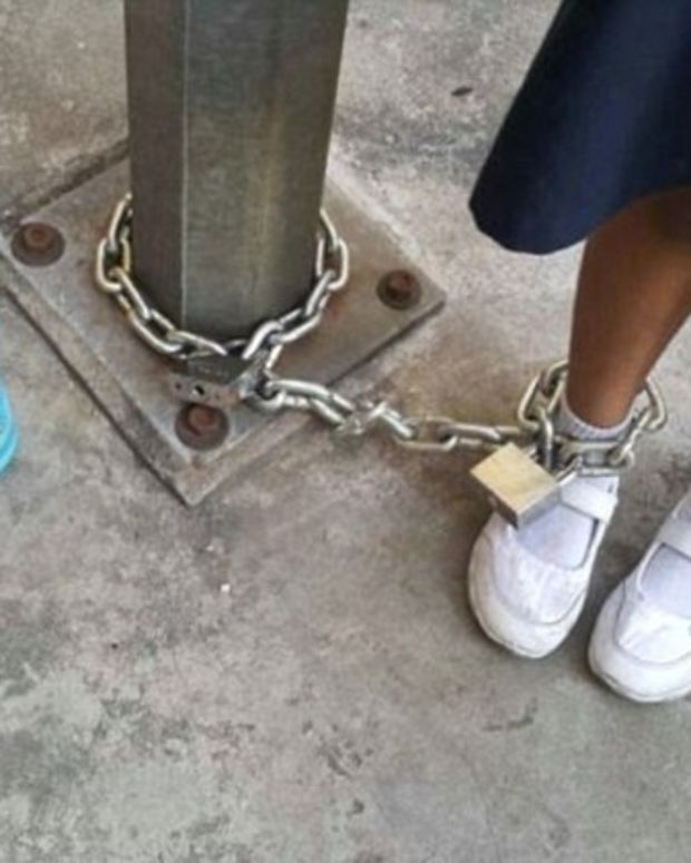 Woman Chains 8-Year-Old Daughter To Playground Pole (Photos) Promo Image