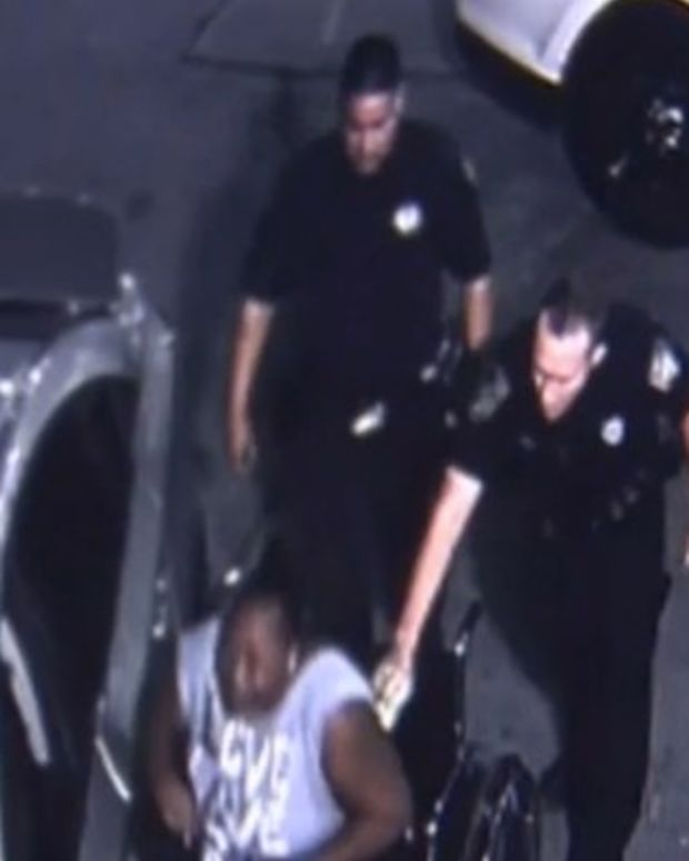 Cop Tases Disabled Black Mom Filming Daughter's Arrest (Video) Promo Image