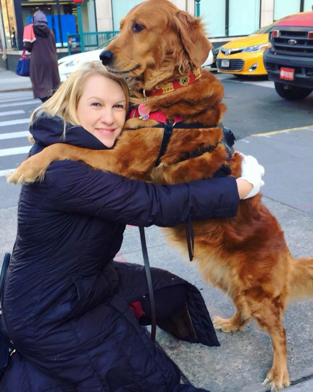 This Golden Retriever Loves To Hug People (Photos) Promo Image
