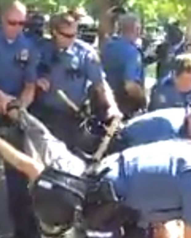 Cops Drag Away Anti-Police Brutality Activist (Video) Promo Image