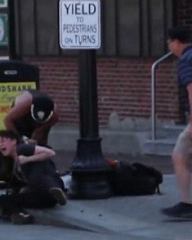 Pit Bull Viciously Attacks Beagle And Owner Promo Image