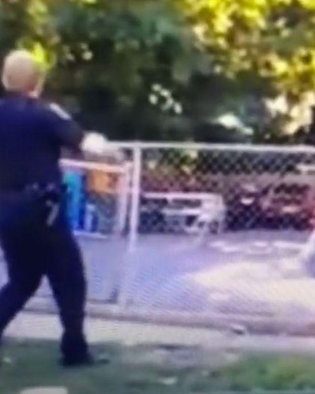 Cops Arrest Female Bystander, Man Filming Them (Video) Promo Image