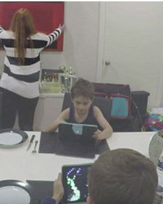 Clip Of Kids Immersed In Gadgets Sparks Debate (Video) Promo Image