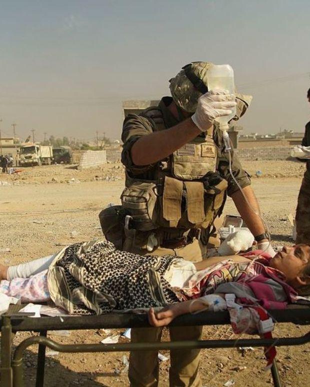 US-Led Airstrike Kills 200 Civilians In Iraq Promo Image