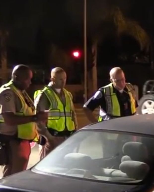 Cops Tow Car, Driver Inside, At DUI Checkpoint (Video) Promo Image