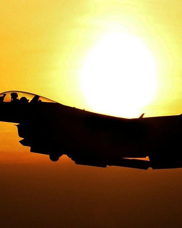 Russia Condemns Shooting Of Syrian Warplane Promo Image
