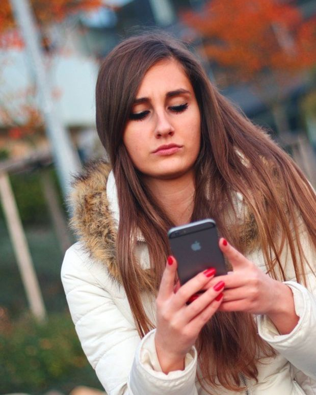 Texting Woman Falls Into Sidewalk Cellar (Video) Promo Image