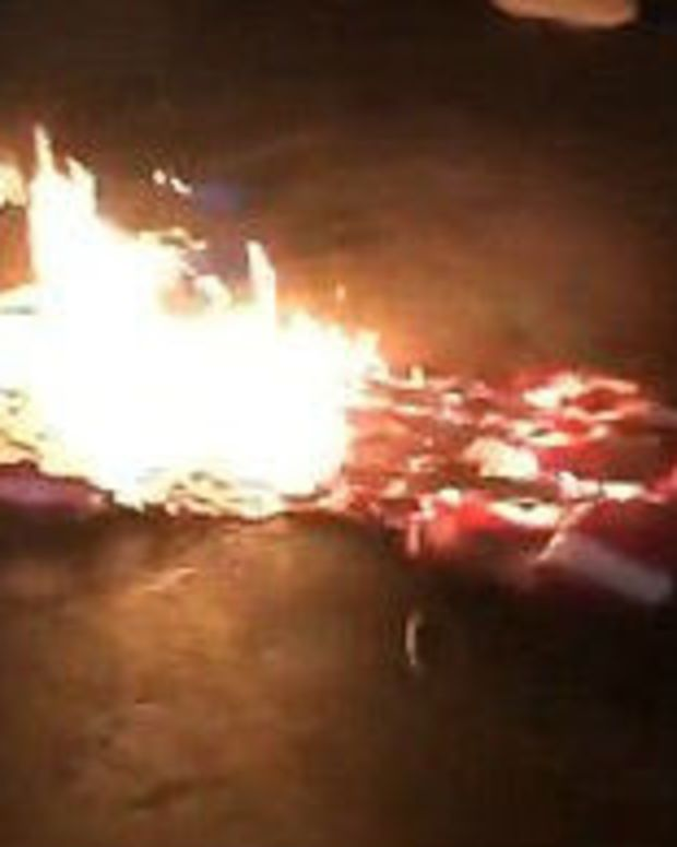Man Accidentally Sets Himself On Fire While Burning Flag (Video) Promo Image