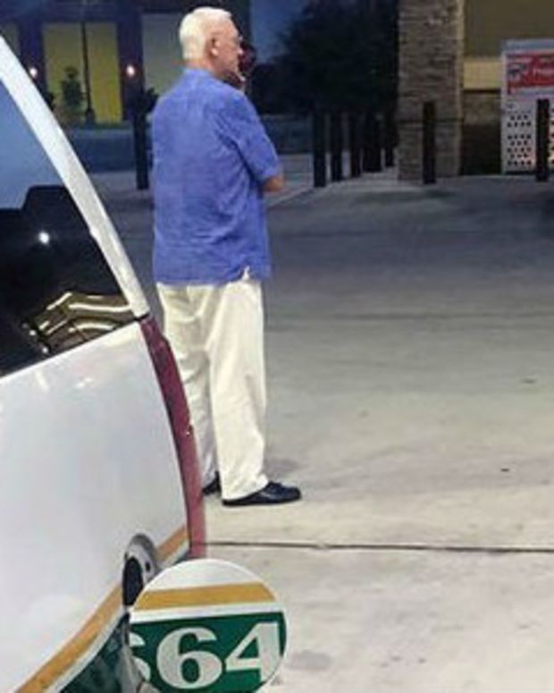 Police Officer At Gas Station Suddenly Notices What Nearby Man Is Doing (Photo) Promo Image
