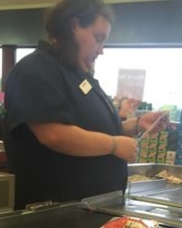 Cashier Helps Pay For Elderly Woman's Groceries (Photo) Promo Image