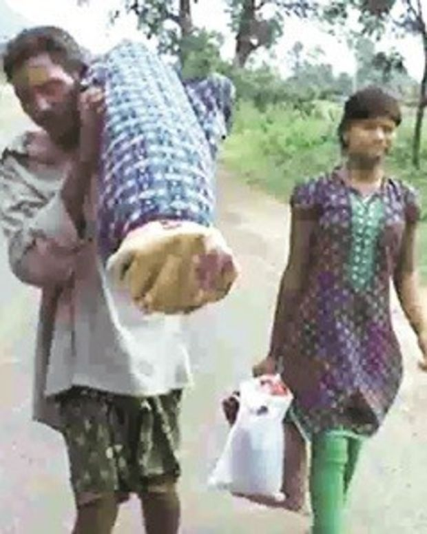 Man Carries Dead Wife On His Back For 6 Miles (Video) Promo Image