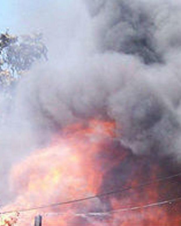 Novelist Runs Into Burning House To Save Laptop (Photo) Promo Image