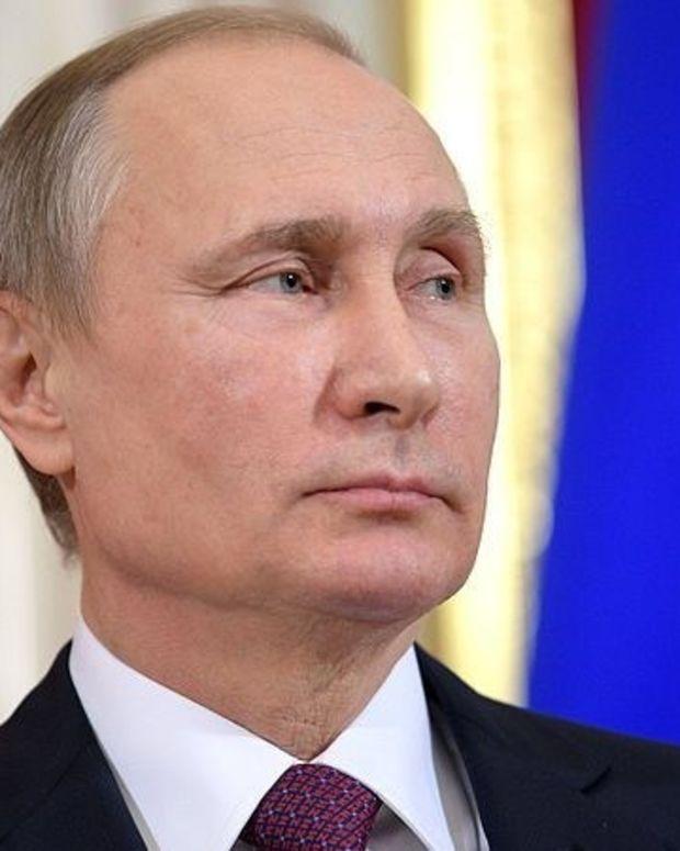 Trump-Putin Handshake Goes Viral (Video) Promo Image