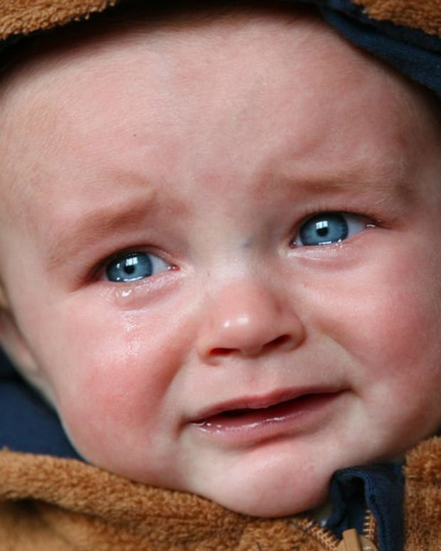 Critics Blast Mom For Piercing Crying Baby's Ears (Video) Promo Image