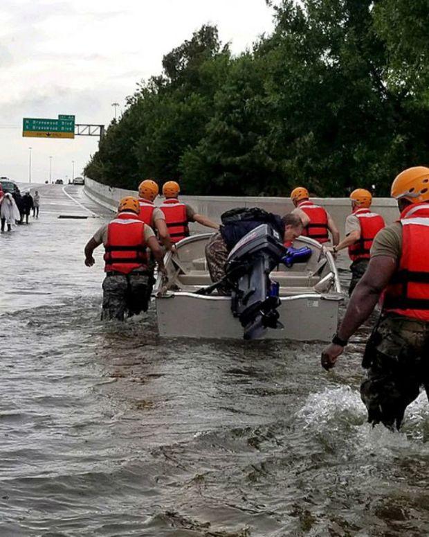 Toddler Wanders Around Hurricane Harvey Floods (Video) Promo Image