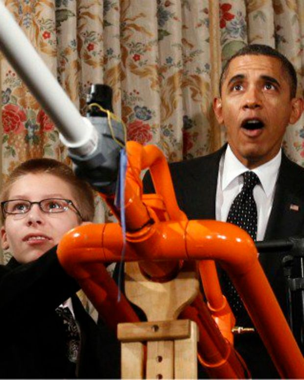 President Obama shoots a marshmallow cannon.