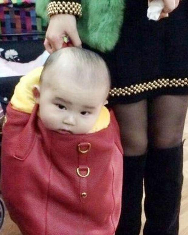 Baby in designer bag.