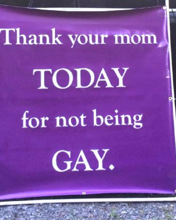 Christian Protester Displays Anti-Gay Mother's Day Sign Promo Image