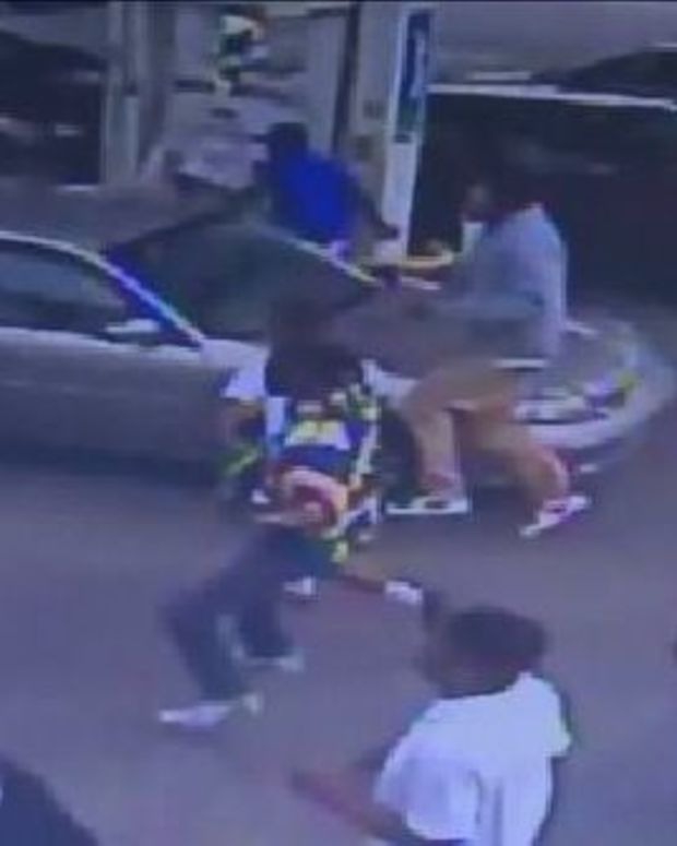 Man Holding Baby Encounters Massive Group Of Teens At Gas Station (Video) Promo Image